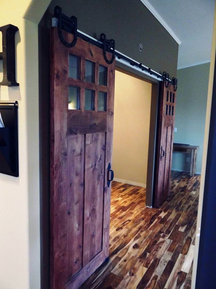 double barn doors interior with glass top and bracket also barn wood floors as well as grey wall painted interior traditional house ideas