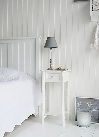 Tall, narrow bedside table to go with tall bed. New England white bedside  table with one drawer and shelf, wnatique brass handle.