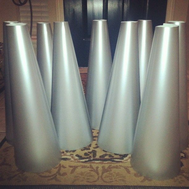 DIY Cheer Megaphones....wanted to order the real things for our cheer banquet tables but just couldn't justify the cost knowing there had to be a way to make them! Wish I would have got pic of final outcome but was so busy at banquet, didn't even think about it...I was so bummed =/ Placed fabric poms next to each one on table