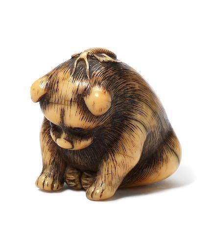 An ivory netsuke of a puppy By Garaku, Osaka, earl…