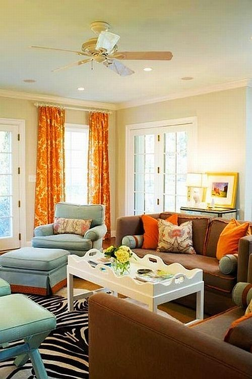 classic living room with brown couches and orange curtains