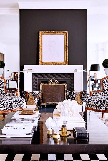 6 Things Every Stylish Person Has At Home// coffee table styling, accent wall, ikat chairs, coral