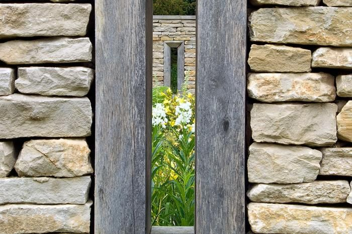 Georgian Rectory in the Cotswolds - new dry stone wall with weathered timber framed openings