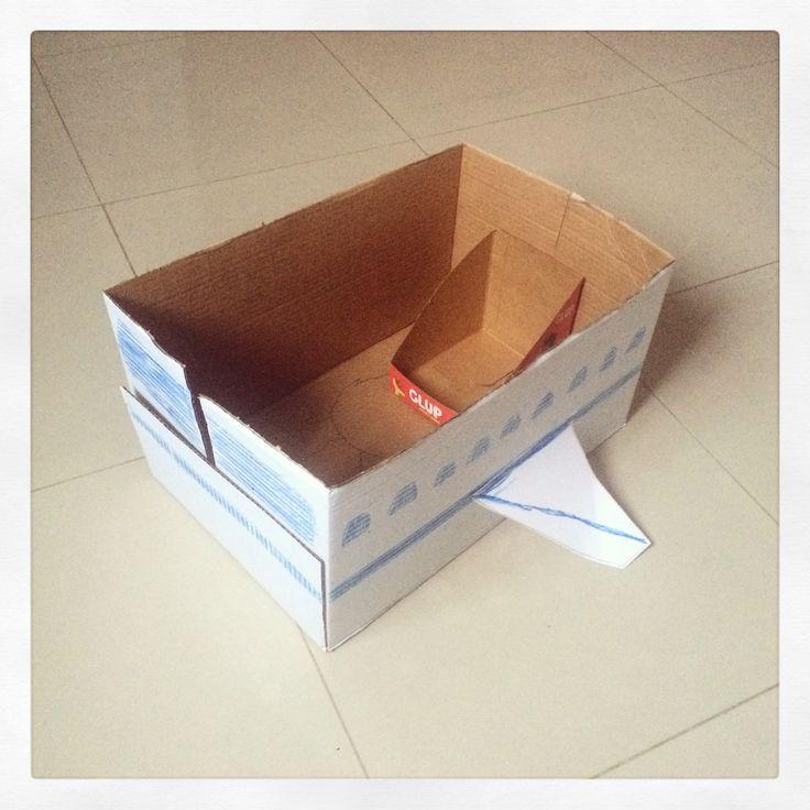 Plane-Carton box, scissors, tape and blue crayola (9yrs. old)