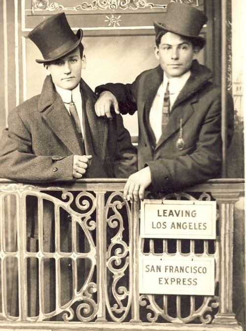 Dapper young men in studio train scene bound for San Francisco from Los Angeles