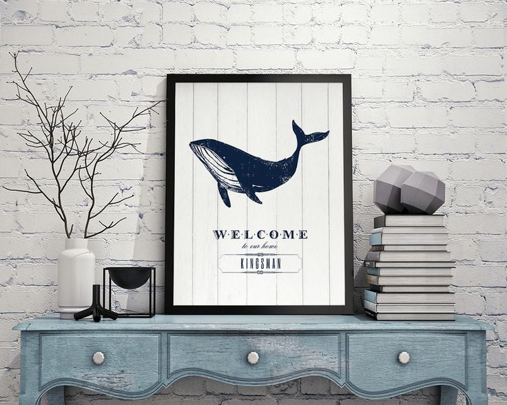 """Nautical themed print. """"Welcome to our home"""" under a drawing of a blue whale. Personalize it with your family name."""