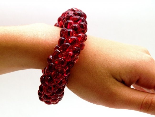 Same Sky Glass Beaded Bracelet - Fire Red. Hand crocheted by HIV + women in Rwanda, these beautiful bead bracelets are the perfect way to say 'I love you' on Valentine's Day!