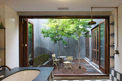 I once saw an ad for a home for sale in Oregon with an Atrium and I fell in love with the idea! If I could ever design my own home, I would add an atrium! I especially am in love with this.. a bathroom with doors that open up to the atrium! As long as no guests were over, you could leave the doors open while you shower and get ready!! LOVE IT!