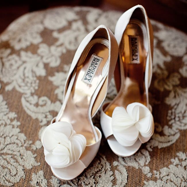 Ivory Bridal Shoes- floral accents to a peep toe heel are elegant for any wedding. photo by: Lisa Hessel Photography  Shoes: Badgley Mischka