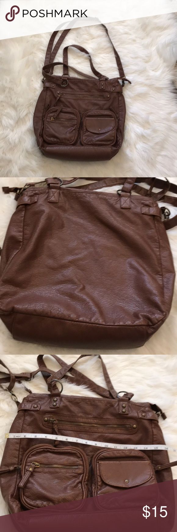 Barbados oversized bag Beautiful faux leather oversized bag perfect overnight, school and traveling gently used minor wear in tear shown in picture very roomy lots of pockets long strap adjustable two short hand straps bronze detailing the bag you need when on the go🆗 🎈Thank you and Happy Poshing🎈 Barbados Bags Crossbody Bags