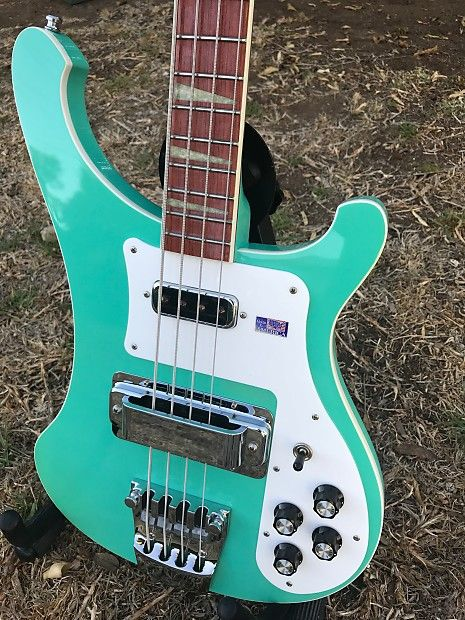 """The real deal! A 2000 Sea Green """"Color of the Year"""" Rickenbacker 4003, all original including the finish, even still has the (worn) Made in the USA sticker on the pickguard. Bass is in very good to excellent condition, lovingly used. If you know anything about Rickenbacker's Color of the Year (CO..."""