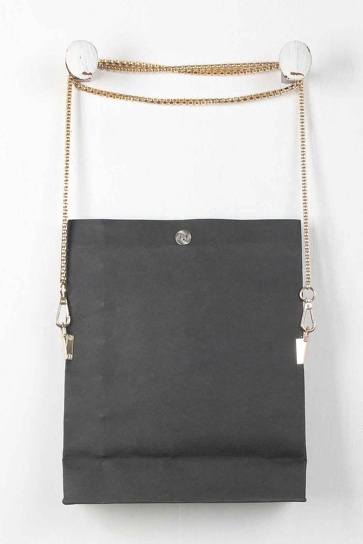 This #bag features a structured rectangular shape, paper bag designed Buy for just $51.68 #handbags #totes #hobos