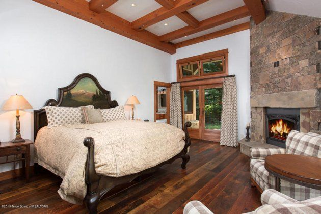 19 (32) bedroom fireplace This is how the world's richest woman lives: Christy Walton's Wyoming estate is for sale