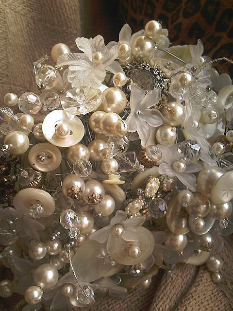 Bead and button bouquet    Cream button bouquet with lots of vintage brooches, mother of pearl buttons and pearl beads.