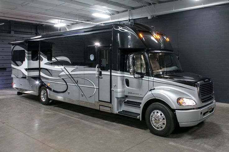 """AMAZINGLY SPACIOUS AND MODERN CLASS C!!!  2017 Dynamax Corporation DynaQuest XL 37RB Spacious. Entertaining. Modern. It's hard to believe that this spacious 41'2"""" long diesel-powered 37RB is only a class C! Check the score of the big game or catch up your favorite show with an outside, living area, and bedroom TVs! You'll also appreciate the convenience of both a half and master bathroom! Give our DynaQuest XL expert Bob Wells a call 616-604-8129 for pricing and more information."""