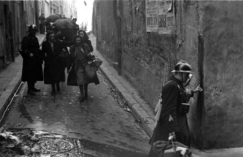 Vichy police escorting French citizens for Jewish deportation in Marseilles, 1943