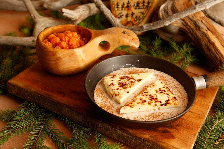 """Bread cheese"" (""leipäjuusto"") served with fresh cloudberries or cloudberry jam -Rovaniemi, Lapland, Finland"
