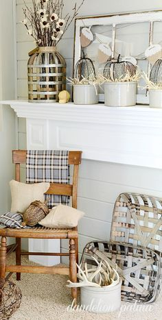 Neutral fall mantel incorporating farmhouse style with vintage wooden chair…