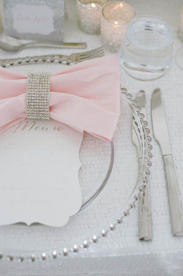 Modern wedding place setting with clear chargers and glitzy napkin holders (Margot Landen Photography)