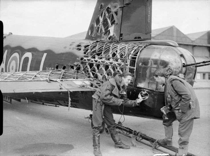 """This image shows the tail and rear fuselage of a Wellington twin-engine bomber. It shows the amount of heavy damage Barnes Wallis' geodesic frame system could sustain yet still keep flying. Wallis was also the innovative inventor of the """"Dambusters"""" bouncing bomb and many other weapons."""