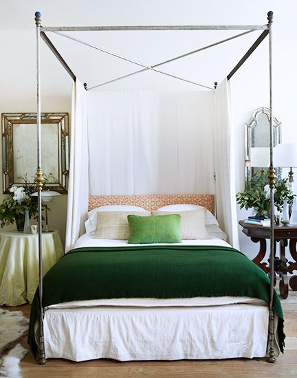 Tour Rose Uniacke's Regal London Townhouse // canopy bed, green blanket