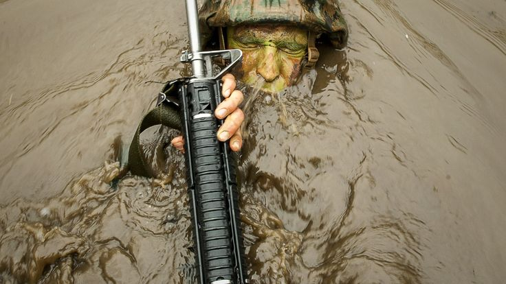 United States Marine Corps officer candidate navigates through the murky water of 'The Quigley' at Brown Field Marine Corps Base Quantico Virginia [2117 x 1191]