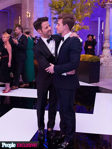 "Inside Nate Berkus & Jeremiah Brent's Dream Wedding | A LOOK OF LOVE | The fashionable husbands – Berkus wore a J.Crew suit, while Brent chose Saint Laurent – embrace after the ceremony. And the night just kept getting better: Marjorie Gubelmann, aka DJ Mad Marj, spun tunes at the reception, while singer Estelle sang her hit, ""American Boy."""