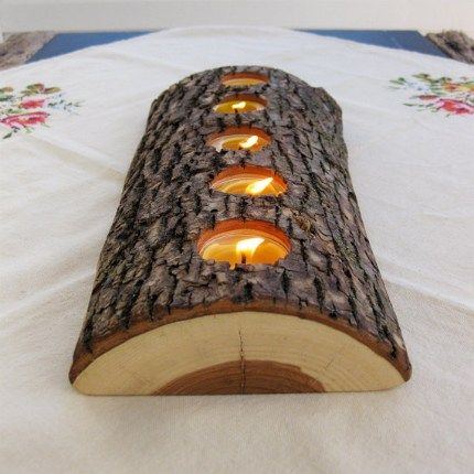 Architecture Art Designconverted a split log into an elegant tealight holder. Check out more of this project here.