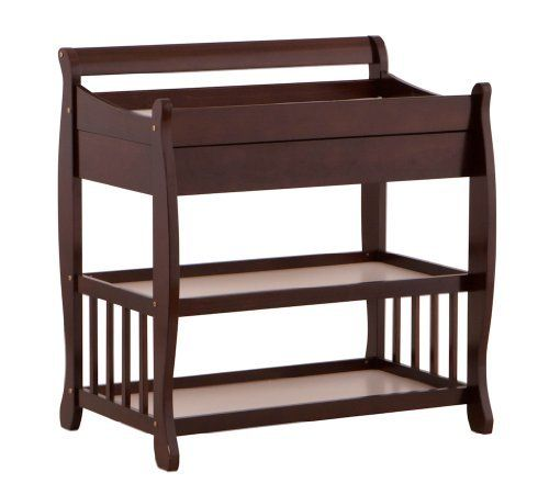 Stork Craft Tuscany Dressing Table, Espresso by Stork Craft. $163.04. From the Manufacturer                Sleigh design change table with over size Drawer. Two large open shelves for storage. Easy to assemble. Made of solid wood and wood products. Includes change pad and safety strap.                                    Product Description                The spacious Tuscany changing table by Stork Craft, with a desired sleigh design, comes with an oversized drawer ...