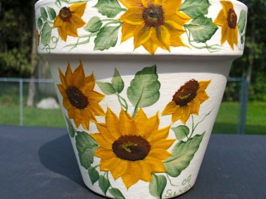 Sunflowers on a clay pot.  One Stroke Painting by Susan Earl.