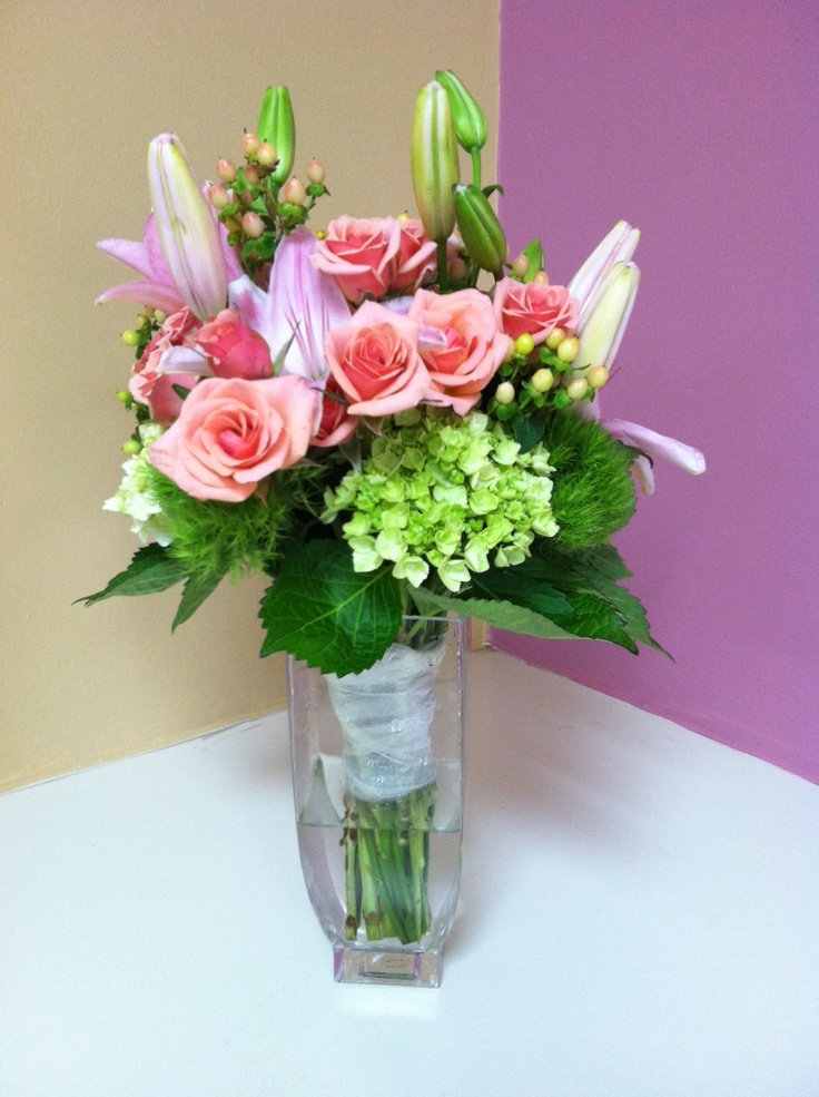 Beautiful Bouquet Of Stargazer Lilies Green Hydrangea And Peach Roses Designed By Rangers Floral Garden