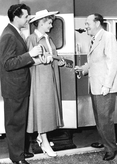 """Lucy and Desi receive a symbolic key to MGM Studios from E. J. """"Eddie"""" Mannix, studio executive, July 1954"""