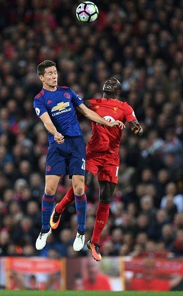 Manchester United's Spanish midfielder Ander Herrera vies with Liverpool's Senegalese midfielder Sadio Mane during the English Premier League...