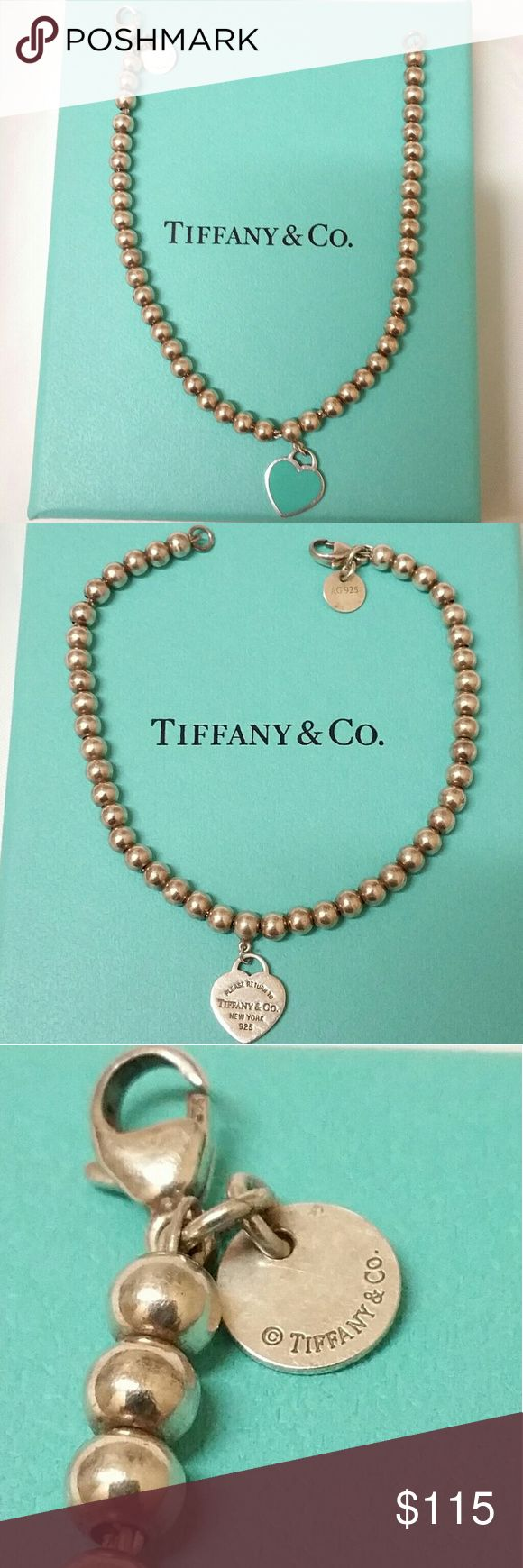 Authentic Tiffany Bracelet 100% Authentic Tiffany beaded bracelet with ceramic Tiffany Blue heart on front and Return To Tiffany on rear. .925 Silver with all the Tiffany signature hallmarks. 7 inches in legth. Pristine condition clean, shiny, and ready to wear. Will be shipped with original box bag bow.  A highly sought-after piece for the avid Tiffany fan. Price is FIRM. Tiffany & Co. Jewelry Bracelets