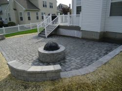 Customized fireplace kit installed by Diamond Run Landscapes makes a beautiful and functional addition to this custom paver patio and sitting wall and enhances this outdoor living space