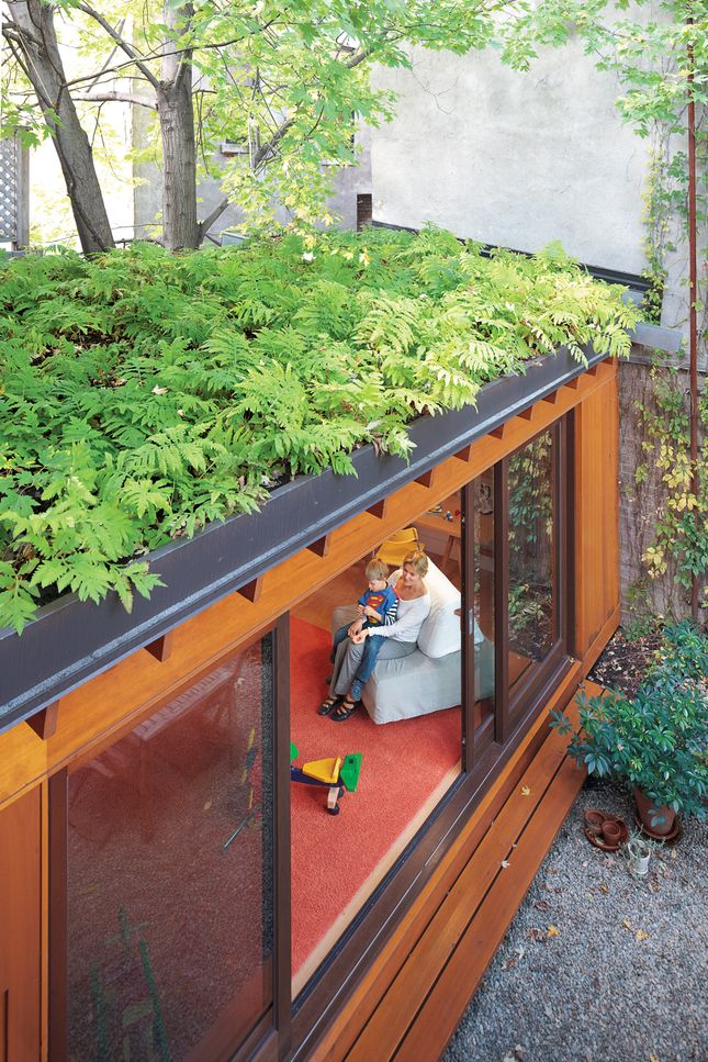 A small, single-story addition to the row house adds a playroom without eating up too much outdoor space. A green roof also helps makes up for lost garden beds, while creating attractive, leafy views from the second and third floors. In summer, when the sliding doors are left wide open, indoor and outdoor spaces blend together.  Photo by: Alexi Hobbs      Read more: http://www.dwell.com/slideshows/separate-boite-equal.html?slide=6=y=true#ixzz25k60tFdz