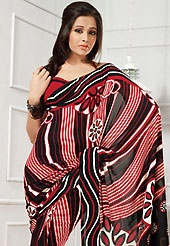 Welcome to the new era of Indian fashion wear. This black, off white and red georgette saree is nicely designed with floral and geometric print work. Saree gives you a singular and dissimilar look. Matching red blouse is available. Slight color variations are possible due to differing screen and photograph resolution.
