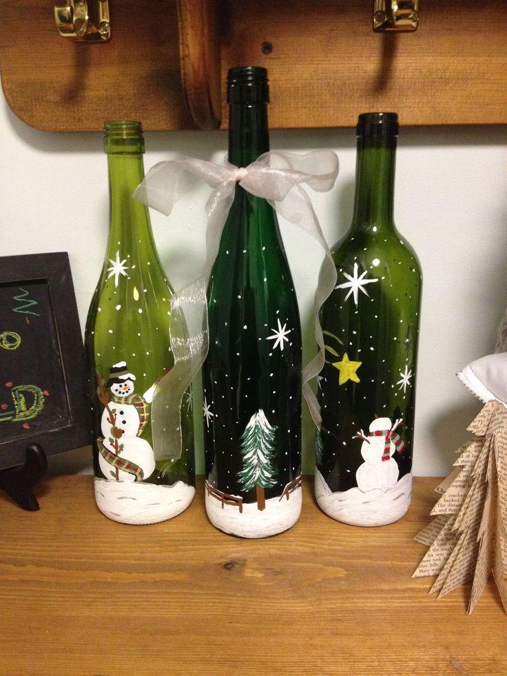 Snowmen painted on wine bottles
