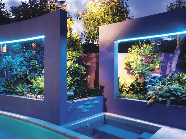 Backyard hot tub garden with awesome LED lights!