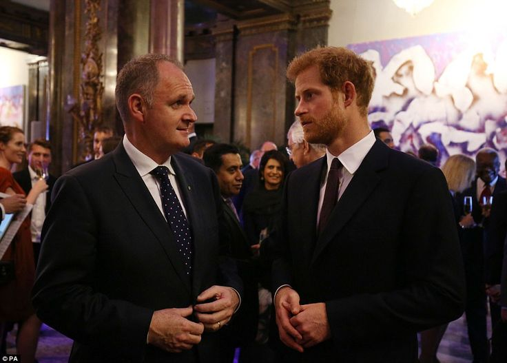 Doting grandson:The 32-year-old royal (pictured chatting to guests) accompanied his 91-year-old grandmother to welcome winners of the 2017 Queen's Young Leaders Awards to a star-studded ceremony at Buckingham Palace