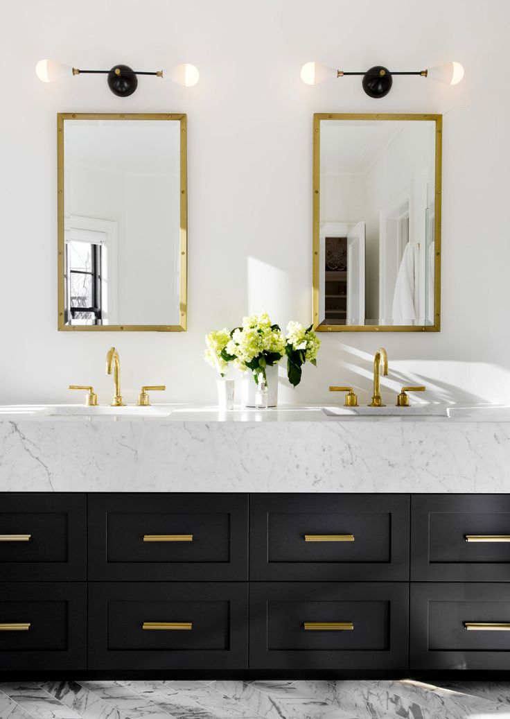 high contrast black and white in his modern bath | house tour via coco kelley