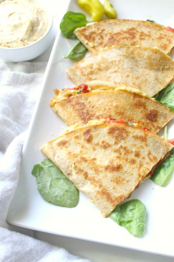 Vegan Snacks: 19 Healthy Snacks for a Vegan Diet | Greatist  If you're looking for something heartier to snack on than just nuts or fruit, these quesadillas fit the bill. With hummus standing in for cheese and extra veggies upping the fiber quotient, they're a fantastic balance of protein, healthy carbs, and produce to keep you going until your next meal.