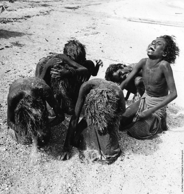 Aboriginal women washing their hair with sand at Arnhem land in the Northern Territory of Australia.1st January 1950