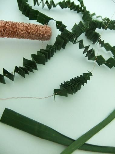 Folding a pleated garland out of foliage