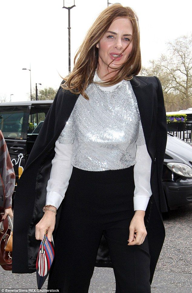 On trend: Presenter and author Trinny Woodall dazzled in a silver sequin top as she headed...