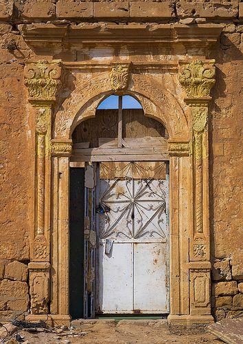 Old colonial house door in Ptolemais , Libya
