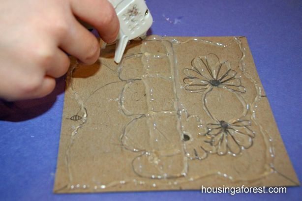 Draw a simple design, go over lines with hot glue, let dry and cover with Tinfoil and color with Sharpies.