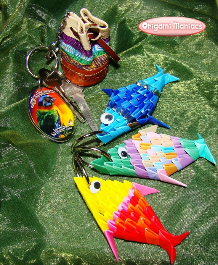Learn how to make these cute fish in http://origamimaniacs.blogspot.jp/2012/05/3d-origami-keyholder-fish.html