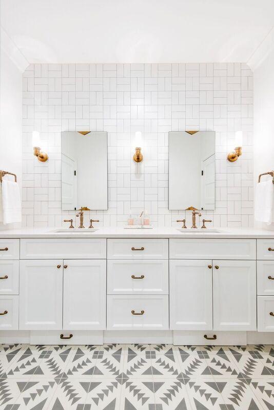 Gorgeous patterned floor and patterned tile make for one fantastic bathroom.