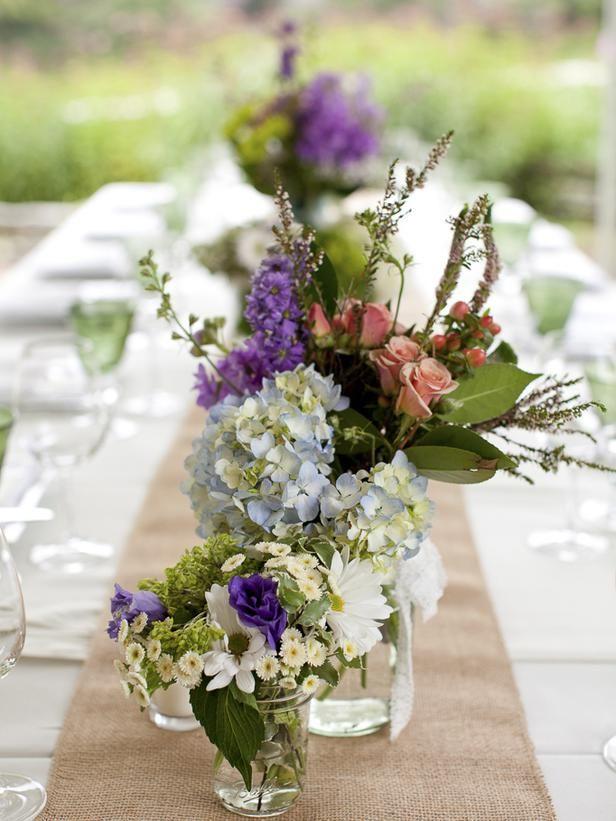 Mason jar vases and burlap table runners >> http://blog.diynetwork.com/maderemade/2013/08/30/rustic-chic-wedding-inspiration?soc=pinterest